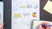A professional worker analysing data with pie charts and graphs